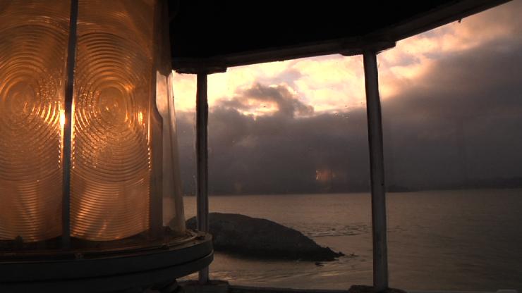 D) Med shot light at dusk, see West Brother Island